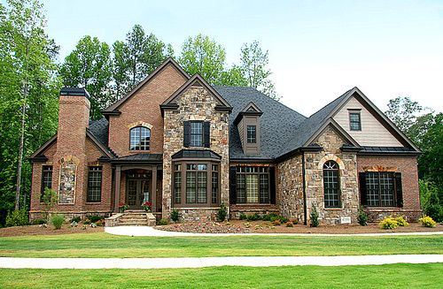 seriously my freakin dream house! I tell Kevin all the time I want a brick/rock/stone house. amazing!!!