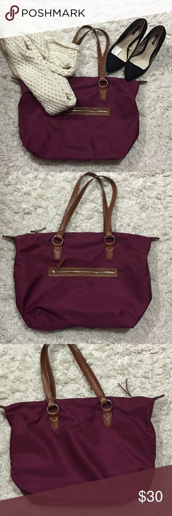 Nylon Handbag Bought this from JC Penny ( listed for exposure) about 4 years ago. it's a deep magenta color with brown straps. It's a big bag can use for school or work will hold all your things. At the end carries a part where you can snap the end to the bag depending on your style! Longchamp Bags Shoulder Bags