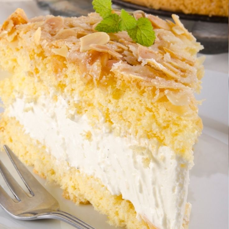 Honey Almond German Cake: a very yummy recipe for honey almond cake with a sweet almond topping and cream filling.