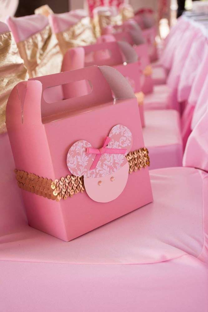 Favor boxes at a Minnie Mouse birthday party! See more party ideas at CatchMyParty.com!