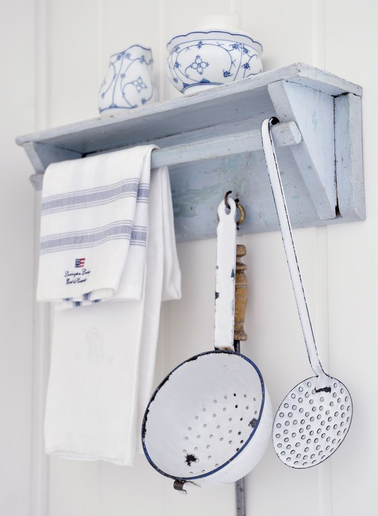 pretty blue and white vintage kitchen enamel and wooden shelf - prettily accessorised with fresh blue and white linen cloth