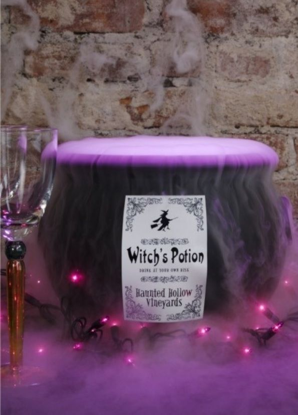 """witches brew cauldron  ,, I actually made a punch that smoked in a black cauldron for our Halloween luncheon at work (attendance required). I won the """"carved pumpkin"""" first prize. The secret ingredient was real wine!!"""