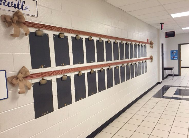 My hallway bulletin board for the year - burlap chevron ribbon, burlap ribbon, & handmade display boards and name tags. :-)
