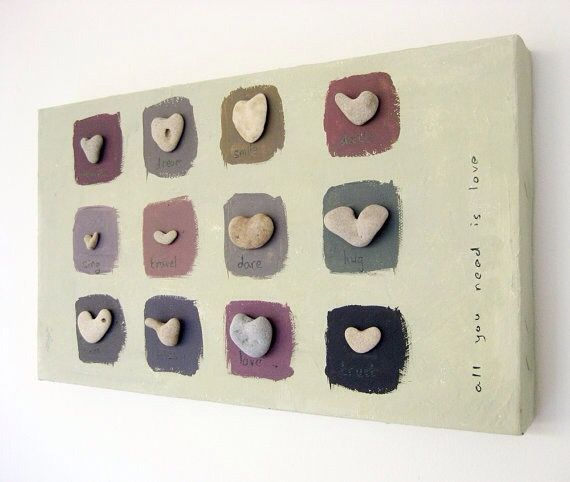 A beautiful display of heart shaped rocks mounted on a painted board.