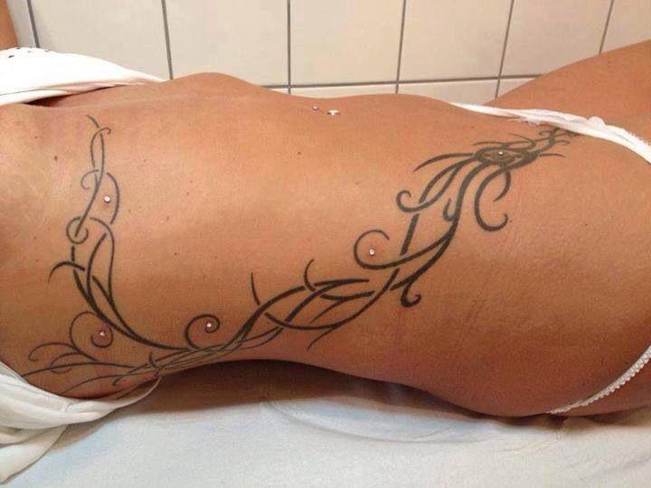 Side tattoo with dermals