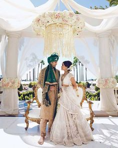 Bride Seema Shah's ivory lehenga by @sabyasachiofficial is straight out of a fairy tale. Would you wear ivory for your wedding?  Couple- Seema Shah and Avinash Chennamsetty Location- Monarch Beach Resort Photo Courtesy- @dukeimages (Pasadena, CA)  #sabyasachimukherjee #sabyasachibride #whitelehenga #ivorylehenga #lehenga #lehengalookbook #bridaljewellery #lehengaideas #bride #indianbride #wedding #indianwedding #weddingsutra #bridallook #dday #bridalshoot #traditional #indianwedding…