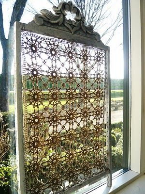 Let the sunshine in! Find a broken dresser mirror or picture frame and attach lace. Then hang it in a small window and let the sunshine in.
