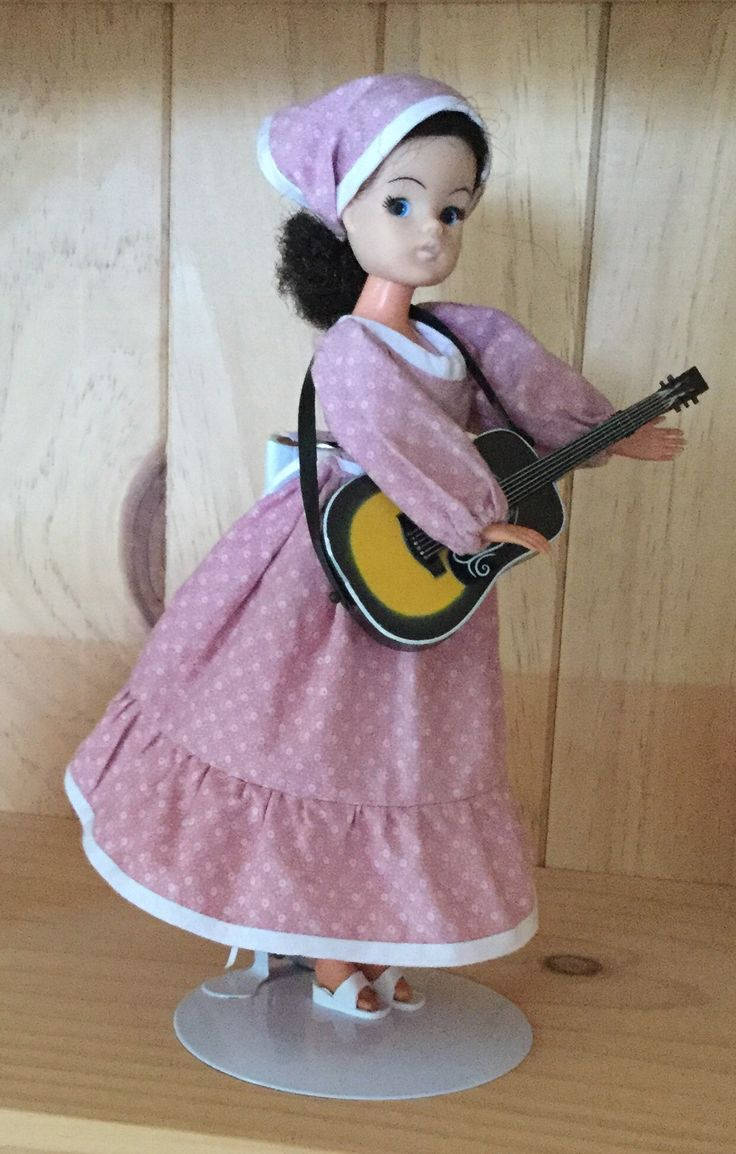 A folk singer Sindy in a Laura Ashley type dress.   Made from an old Sindy pattern with my own twist