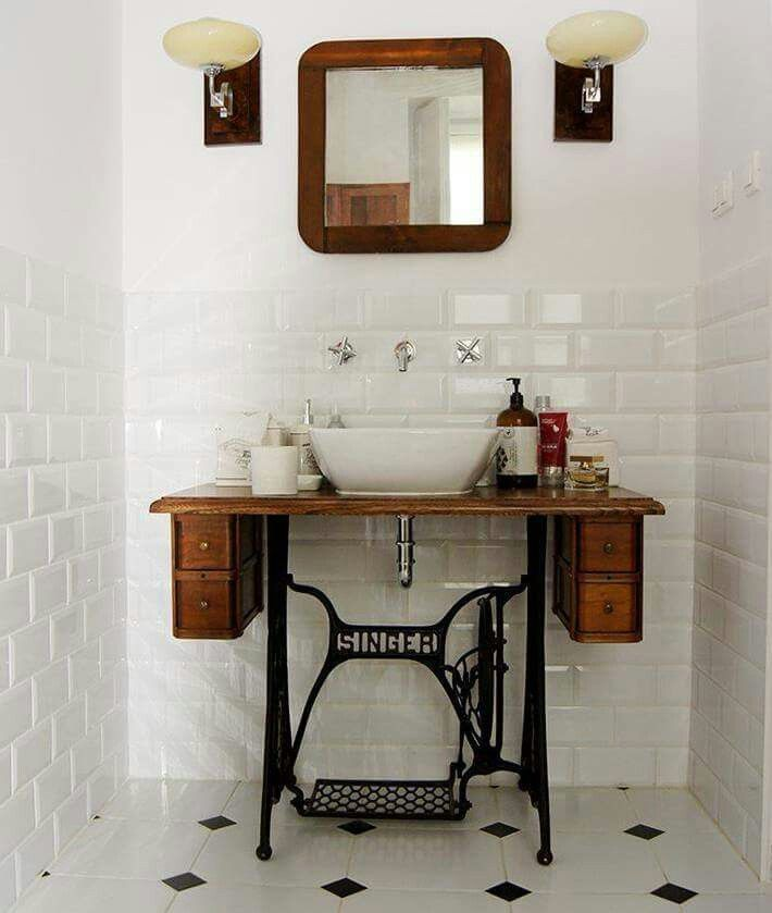 I love the old singer bench used as a stand for this sink. Not such a fan of the subway tiles.