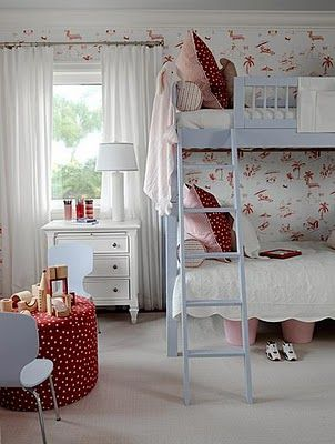 girls room bunk beds and desk in front of window