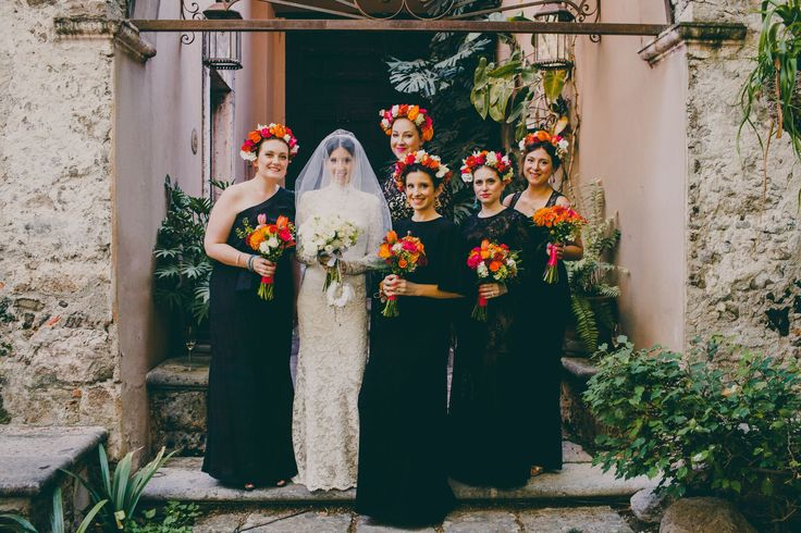 Frida Kahlo inspired wedding in the jungles of Mexico at Casa de Tortugas. Bridesmaid with floral crowns and long black dresses. Photo: Pierce Lifestyle Photography