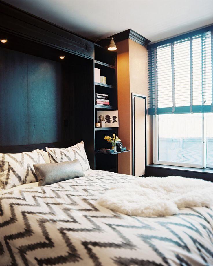 Eclectic Bedroom: Chevron-print bedding on a Murphy bed with built-in bookcases.