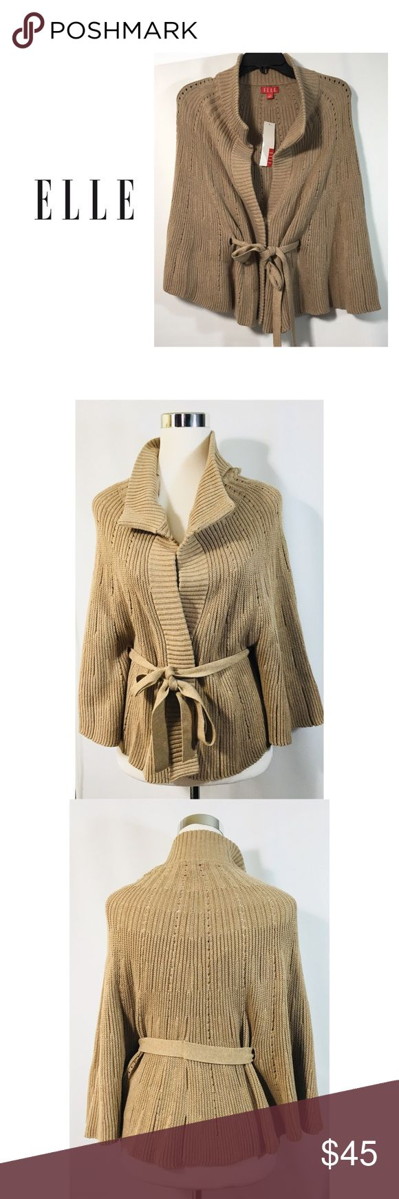 """NWT ELLE Womens Sz M Tan Sweater Cape With Tie A Soft Cape sweater with tie in a Tan color, by ELLE.      Size: M     Length Approx. 23""""     Shoulder to Shoulder flat Approx. 19""""     Flat across Middle Approx. 23""""     3 Front snap closure buttons ( extra included)     V-neck- Ribbed Collar     Three-quarter sleeves     60% Cotton/40% Acrylic     Brand new with tags           # 000-0218 ELLE Jackets & Coats Capes"""