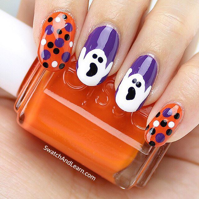 """A final look at my Hallowe'en manicure. Maybe the ghosts are actually screaming, """"Roarrrrange!"""" 👻 It's the Essie nail polish I used for my Hallowe'en nail look yesterday, which is featured on SwatchAndLearn.com today! (Clickable link in profile.)"""