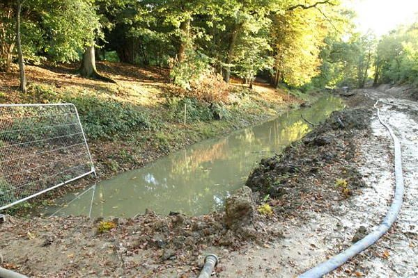 The summit pound of the Wey & Arun canal near Dunsfold during de-silting and bank re-profiling. October 2013.