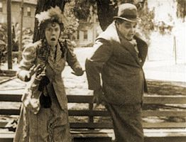 """Louise Fazenda and Roscoe Arbuckle in """"Fatty's Tintype Tangle"""" (1915) directed by Roscoe Arbuckle"""