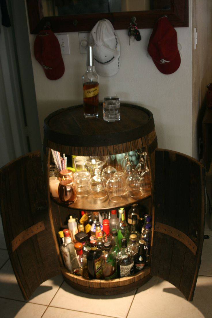 Whiskey barrel bar cabinet, I wonder if I can make this into a cigar humidor? That would be sick.