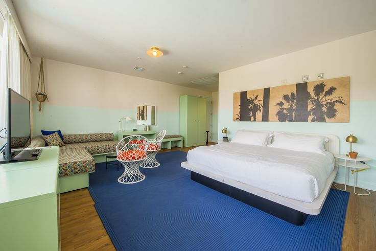 Woke Up In The Hall - South Beach Hotel | Pastel colored walls and palm tree prints at this classic South Beach hotel.