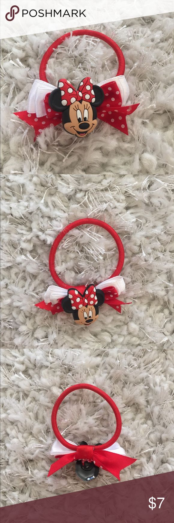 Disney Minnie Ear Bow Hair Elastic Ponytail Holder Disney Minnie Ear Bow Hair Elastic Ponytail Holder. Never used. Purchased at Disneyland. Disney Accessories Hair Accessories