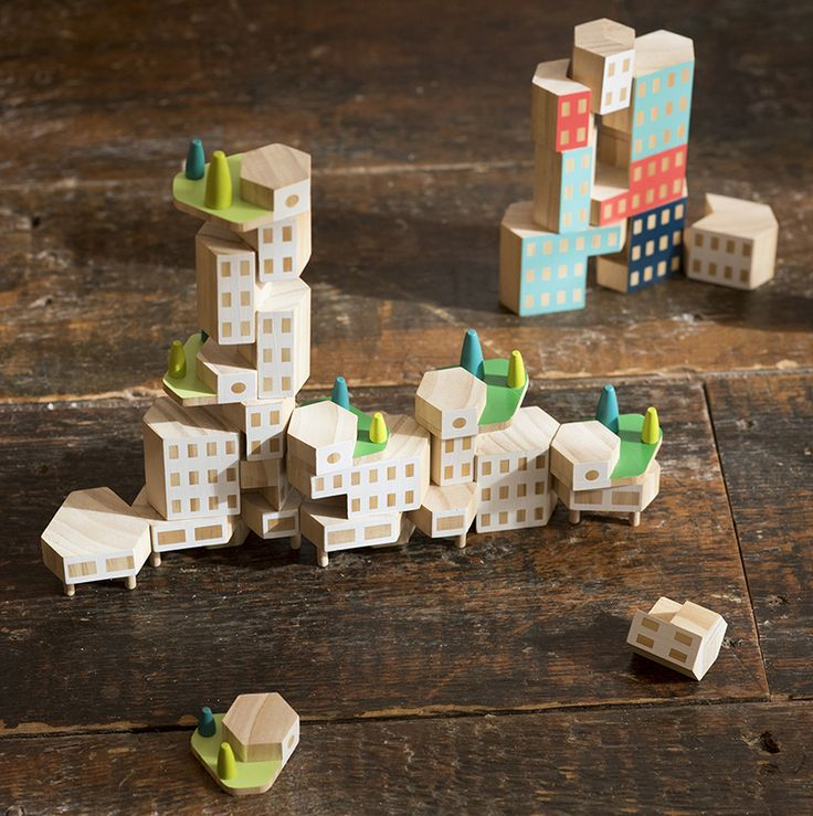 30+ Gift Ideas For The Modern Kid In Your Life | Build cities and knock them down with these durable and uniquely shaped wood blocks that come either with a natural finish or in pastel colors.
