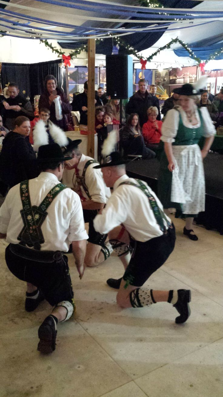 """Schuhplattlers dancing at Christmas Village in Baltimore. The Schuhplattler certainly belongs to the most characteristic of all Bavarian forms of expression. The word """"Schuhplattler"""" has its origins in the fact that the dancer strikes the soles of his shoes ('Schuhe') with his hands held flat ('platt'). Come and join us for the German-American Weekend!"""