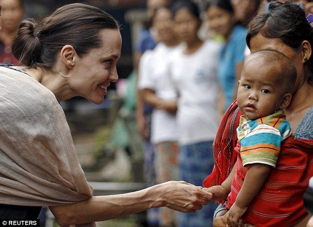 Displaced:Angelina Jolie and son Pax today met the children who have fallen victim to a civil war in a troubled Burmese state