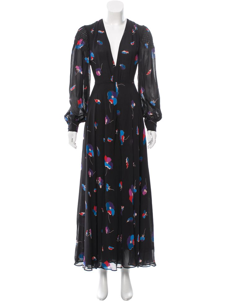 Black and multicolor Jill Stuart long sleeve jumpsuit with watercolor print throughout, V-neck, oversize silhouette at legs and concealed zip closure at back.