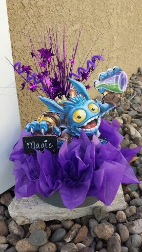 Centerpiece for my son's Skylanders party!  Not to shabby.  Incorporated a couple of ideas I saw on Etsy.  Materials from Dollar Tree and Walmart!