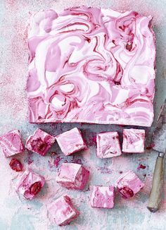 If you've never made marshmallows before then this is the best recipe. We love the rich raspberry ripple, that's easy to achieve. Make for a gift, afternoon tea or a dinner-party dessert.