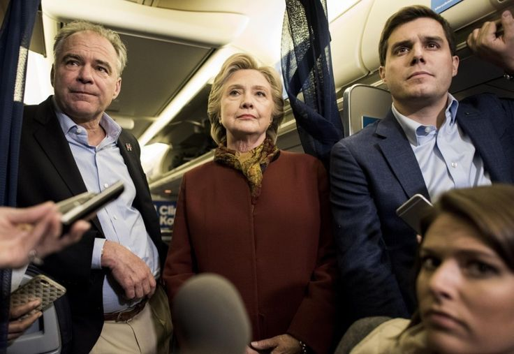 Oct 22. Clinton, Kaine criticize Trump's Gettysburg pledge to sue his accusers - The Washington Post caption: Democratic presidential nominee Hillary Clinton and her running mate, Sen. Tim Kaine (Va.), speak to journalists aboard their campaign plane in Pittsburgh on Oct. 22. (Melina Mara/The Washington Post)