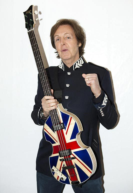 Sir Paul McCartney...With His Famous Left Handed Guitar...After Seeing Paul Live in the 1990's, I Discovered That Rickenbacker Guitar Surely Could Make Some Great Licks In Paul's Hands...Wow...What A Talented Man!!