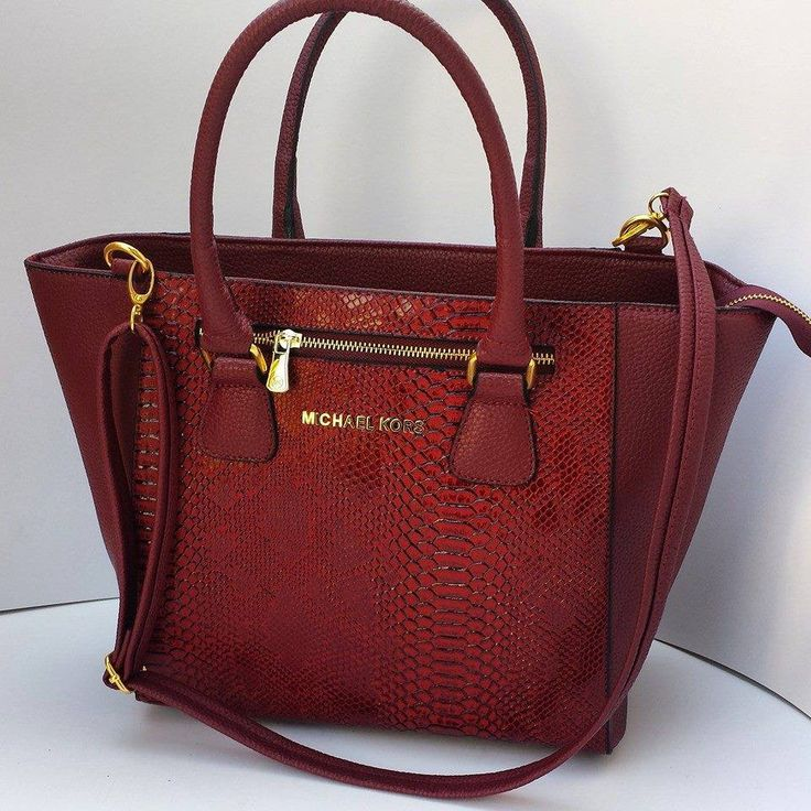 The MICHAEL Michael Kors line was launched in , joining the original Michael Kors Collection label. The MICHAEL Michael Kors line includes women's handbags and shoes as well as women's ready-to-wear apparel.
