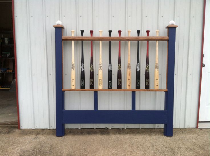 Headboard made from baseball bats.