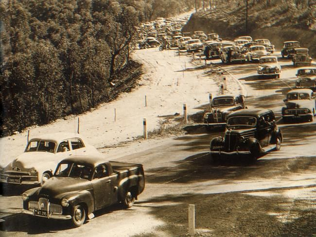 Traffic heads up the winding road to the Adelaide Hills for Oakbank race meeting in 1954.