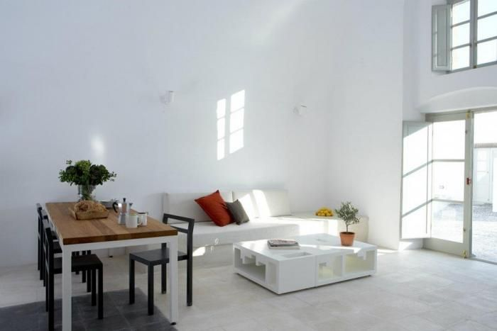 architect Yannis Kaklamanis overhauled the interiors of a former wine facility, creating a sleek and minimal loft–style vacation retreat on the island of Santorini.    The compound consists of four separate residences, joined by communal outdoors spaces; Kaklamanis has restored the interiors using traditional materials like polished cement combined with sleek stainless kitchens and modern baths. The villas are available for rent; for information, go to Villa Fabric