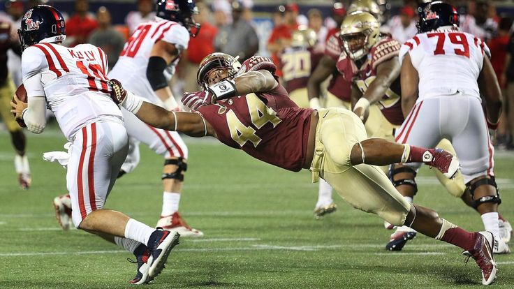DeMarcus Walker collects one of 4.5 sacks on Ole Miss QB Chad Kelly during the 45-34 FSU victory.  GO NOLES!