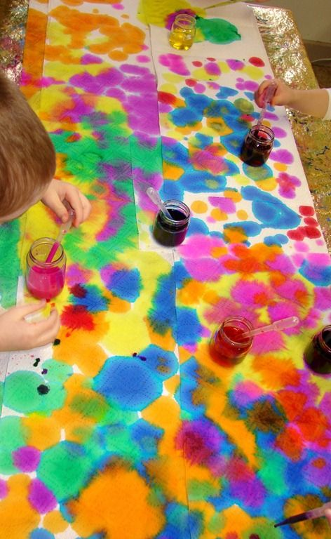 Using droppers with food colouring onto paper towel... Teach the kids about colours and mixing them