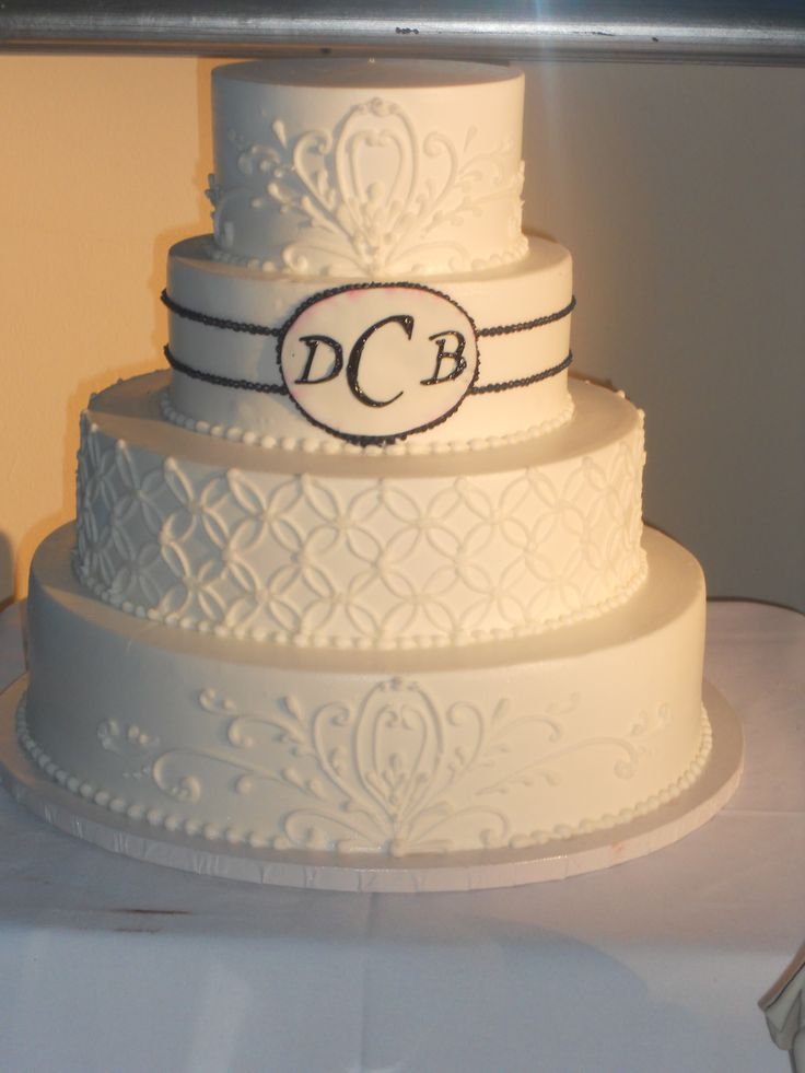 Beautiful all White Wedding Cake with Initials