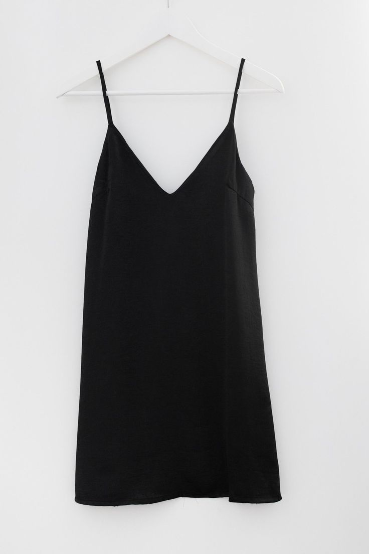 - Minimal slip dress - V neckline and V back - Spaghetti straps - Pairs perfectly with a long sleeve mock neck crop top! - Beautiful shiny and soft satin material - Available in Black or Blush - Fully