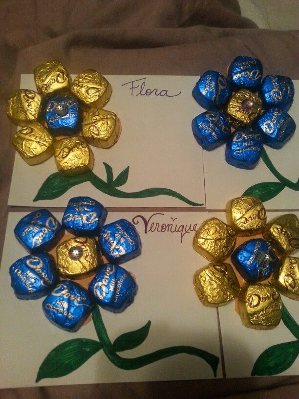 Dove chocolate flowers glued on envelopes with thoughtfull notes inside.♥ office appreciation ♥