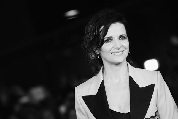 Image has been converted to black and white.) Juliette Binoche walks a red carpet for 'The English Patient - Il Paziente Inglese' during the 11th Rome Film Festival at Auditorium Parco Della Musica on October 22, 2016 in Rome, Italy.