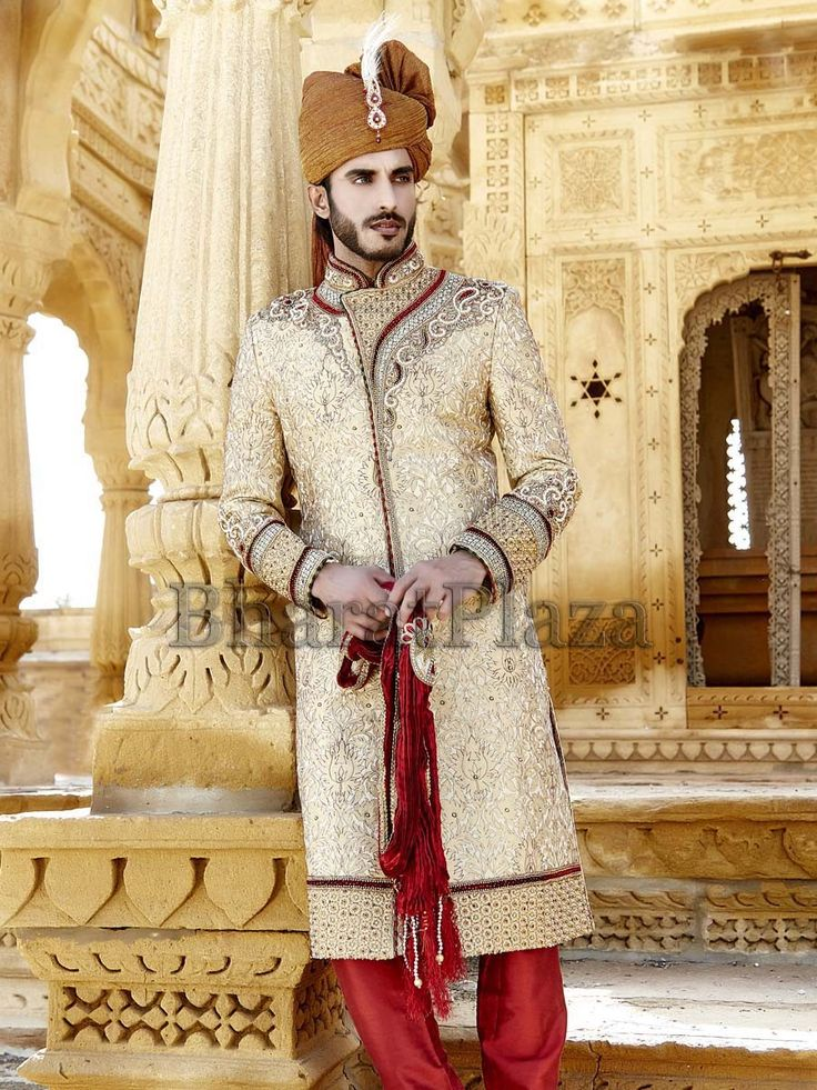 Stunning cream color #Sherwani planed on floral jacquard fabric with cutdana and stone work. Item Code : SSJ8347 http://www.bharatplaza.com/new-arrivals/sherwanis.html.