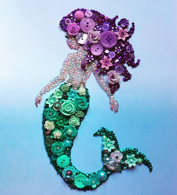 How gorgeous is this mermaid!!?? It would be a stunning unique gift for someone special or yourself! The background is a blue ombré effect and the mermaid herself is made from Buttons, resin flowers, pearls and diamantes in purple and teal - all individually hand placed. She is just