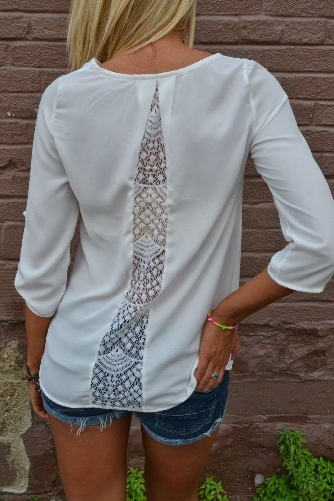 Transform a shirt with a lace insert in the back. Great for shirts that are too tight, too.