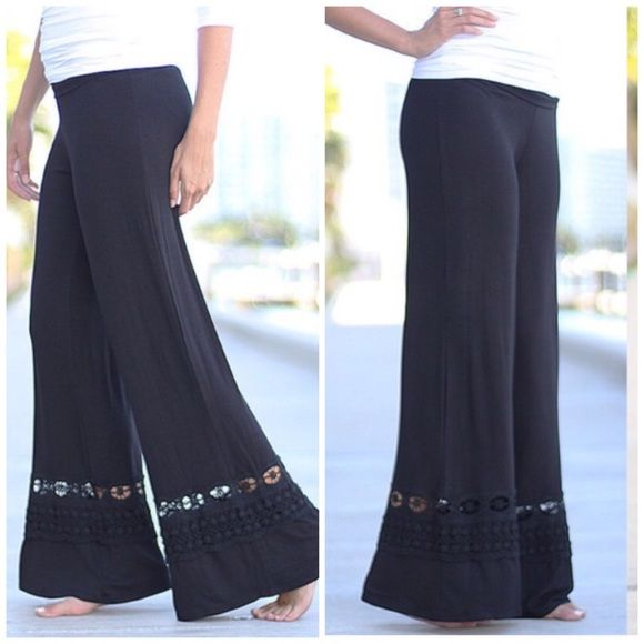 Black Palazzo Pants Lace trim edge fabulous rollover waist band . Loose fit Made in the USA great quality rayon and spandex blend Available in Heather gray Also. Runs big do to stretch . Vivacouture Pants