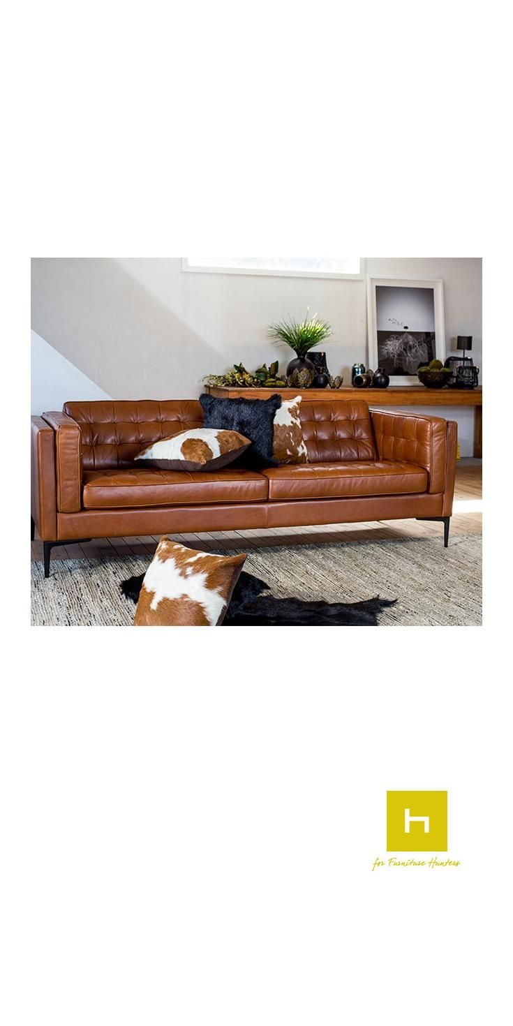 The Gilmour Sofa as shown above is covered in top quality Aniline leather, which is luxuriously soft to the touch. This beautiful leather is matched perfectly with stand out matt black feet.  Influenced by the American Mid-Century Modernist Movement, see stylish design matched with superior comfort in the Gilmour Sofa #furniturehunters #sofa #loungesuite #leather #cowhide #cushions