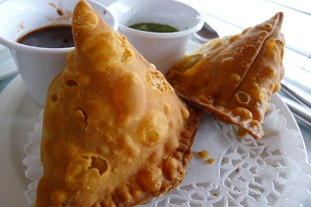 East Indian food- Samosas. A crispy appitizer that can be filled with a combo of potatoes, veggies, peas, etc. It usually is served with tamarind or mint dipping sauce.