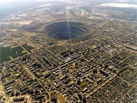 The Mirny Diamond Mine is 525m deep and has a diameter of 1200m. It was the first, and one of the largest, diamond Pipes in the USSR. It is now abandoned. While it was still operational, it would take two hours for trucks to drive from the top to the bottom of the mine.