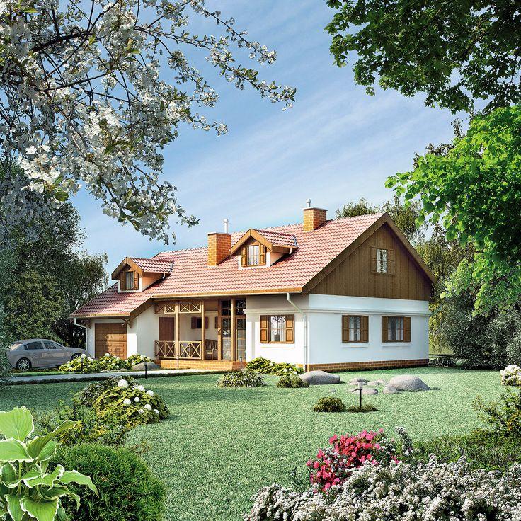 """""""Szczególny"""" dom: zgrabny, ładny, funkcjonalny i wyjątkowo dobrze wpisujący się w otoczenie. Jego największymi atutami są nieskomplikowana bryła przykryta prostym, dwuspadowym dachem oraz wysmakowane, dodające uroku detale architektoniczne – malowniczy ganek, lukarny, drewniane okiennice, gzyms."""