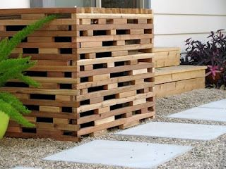 Hide your AC unit with this simple privacy screen. Could work for trash cans too.